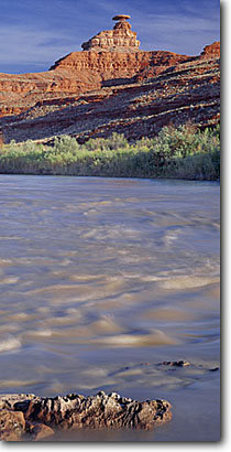 Stock photo. Caption: San Juan River   and Mexican Hat Rock Navajo Indian Reservation San Juan County,  Utah -- deserts canyon country parks southwest united states landscape landscapes  red rock canyons america slickrock rivers formation unusual formations named reservations geology erosion eroded panoramic panoramics panoramas landmark landmarks panorama sunny