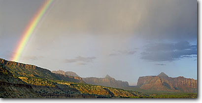 Stock photo. Caption: North and South Guardian Angels    in Zion National Park    from North Creek Valley Colorado Plateau,  Utah -- deserts canyon country parks southwest united states landscape landscapes red rock canyons america slickrock rainbow rainbows southwestern weather rain rainstorm rainstorms panoramic panoramics panoramas panorama scenic butte buttes geology phenomenon