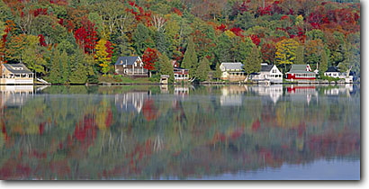 Stock photo. Caption: Joes Pond West Danville Washington County New England,Vermont -- united states america fall color colour colours colorful town towns villages village northeast northern quaint reflection reflections house houses home homes panoramic panoramics panoramas building buildings foliage landscapes scenics  scenic views very
