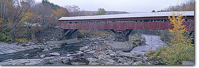 Stock photo. Caption: Taftsville Covered Bridge Built in 1836 Woodstock Vermont -- united states america sierras bridges span spans spanning rivers historic historical nostalgia nostalgic americana  eastern new england panoramic panoramics panoramas