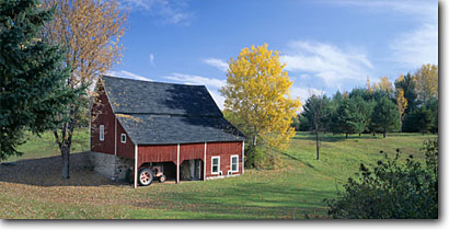 Stock photo. Caption: Barn Merrill Lincoln County Wisconsin -- panorama panoramas panoramic panoramics byway byways backroads backroad barns farms rural pastoral country living family tractor autumn fall road roads building buildings nostalgia bucolic farming ranching ranch tractors implements