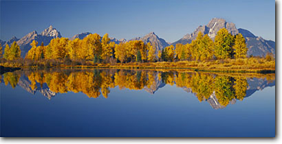 Stock photo. Caption: Pond, Willow Flats Mt. Moran and the Grand Teton Grand Teton National Park Rocky Mountains,  Wyoming -- parks snow peak aspen fall autumn color colors range parks trees tree ranges peaks landscape landscapes tourist travel vacation destination destinations tetons crisp clear serenity serene panoramic panoramics panoramas sunny blue clear skies reflections