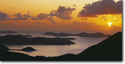 Stock photo. Caption: Coral Bay and Norman Island   from Bordeaux Mountain Saint John United States Virgin Islands -- seascape seascapes sunrise dawn caribbean tropical bays sunny warm away exotic romantic getaway vacation destination destinations  poetic picturesque coastline dreamy dramatic panoramic panoramics panoramas panorama scenics scenic peaceful tropics ocean