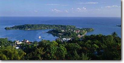 Stock photo. Caption: Port Antonio, Navy Island    and Caribbean Sea    from Bonnie View Jamaica -- tourist destination destinations travel tropical seascape seascapes aqua blue exotic warm climate jamaican leisure tourists vacation vacations harbour harbor harbours harbors islands romantic honeymoon panoramic panoramics panoramas sunny tropics building
