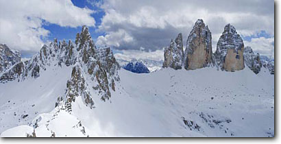 Stock photo. Caption: Paternkofel and Tre Cima Di Lavaredo Val Fiscalina Dolomites Sudtirol, Italy -- solitude dramatic awesome snow mountains expanse cold winter scenic scenics landscape landscapes sunny mountain extreme destination destinations alpine backcountry european europe panorama panoramic panoramas scene dramatic