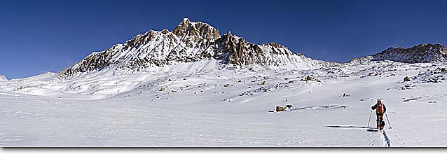 Stock photo. Caption: Ski touring below the Paiute Crags John Muir Wilderness Sierra Nevada California -- people outdoor recreation crosscountry freedom solitude excitement skiers snow panoramics expanse vast sports sport cold winter scenic scenics landscape landscapes mountain extreme skiing destination destinations mountain skier skiing panorama panoramas