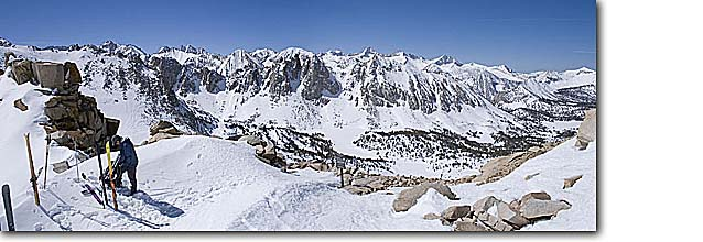 Stock photo. Caption: Backcountry skiers at Kearsarge Pass John Muir Wilderness and Kings Canyon National Park boundary Sierra Nevada, California -- people outdoor recreation crosscountry freedom solitude excitement skiers snow panoramics expanse vast sports sport cold winter scenic scenics landscape landscapes mountain extreme skiing destination destinations mountain skier skiing panorama panoramas
