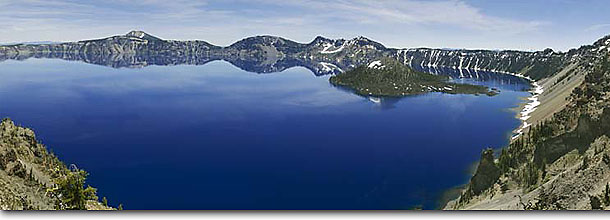 Stock photo. Caption: Wizard Island Crater Lake Crater Lake National Park Cascade Range,  Oregon -- Keywords: panoramic panoramics landscape landscapes united states america scenic shore shoreline lakes sunny clear sky skies blue high mountain mountains summer spring lakeshore lakeshores panorama panoramas islands parks blue trail trails