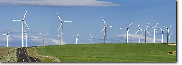 Stock photo. Caption: Electric generating windmills    Highway 206    between Condon and Wasco Sherman County,  Oregon -- Keywords: panoramic panoramics landscape landscapes united states america scenic sunny clear skies blue summer spring panorama panoramas windmill modern generation green power alternative energy wind farms scenic scenics generate road roads