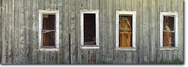 Stock photo. Caption: Outside windows   of abandoned homestead   near Izee Grant County, Oregon -- Keywords: panoramic panoramics landscape landscapes united states america summer spring panorama panoramas  building buildings wooden nostalgia farms homesteads scenic scenics window artistic nature dreams