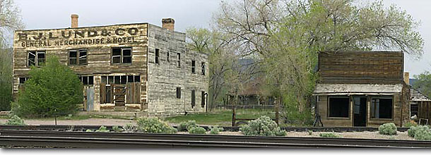 Stock photo. Caption: Historic buildings Modena Utah -- Keywords: panoramic panoramics landscape landscapes united states america scenic sunny clear skies blue summer spring panorama panoramas wooden nostalgia farms homesteads scenic scenics historical train tracks track railroad abandoned