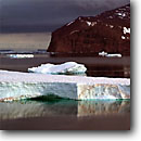 Stock photo. Caption: Icebergs and red basalt cliffs  at Cape Adare, Ross Sea Southern Ocean Antarctica -- Keywords: