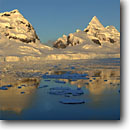 Stock photo. Caption: Glaciers cutting through snow  covered mountains, Amundsen Sea Southern Ocean Antarctica -- Keywords: