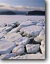 Stock photo. Caption: Ice cakes at low tide Somes Sound with Bar Island Acadia National Park Mount Desert Island,  Maine -- united states america shoreline shorelines eastern east coast snow snowy icey winter parks cold winter snow snowfall snowfalls atlantic seaboard seascape seascapes new england coast coastline coastlines islands