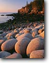 Stock photo. Caption: Granite boulders   and Otter Cliffs Acadia National Park Mount Desert Island,  Maine -- polished rocks cobble rocky beach beaches sunrise sunrises parks atlantic coast ocean seascape seascapes england northeast northeastern travel tourist destination destinations tumbled tideline tidelines round rounded oceans coastlines coastline forms form